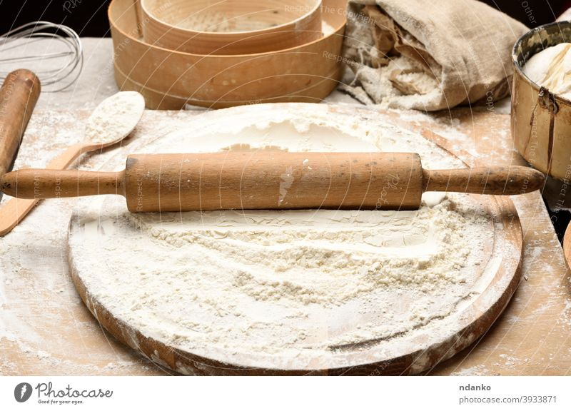 white wheat flour and wooden rolling pin on board, baking ingredients sieve dough food fresh freshness grain homemade kitchen meal pastry powder preparation raw