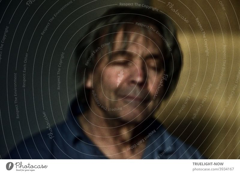 *700* Selfie of the photographer looking at the secrets of his inner world with Corona hairdo and closed eyes in low light and out of focus. portrait Man Face