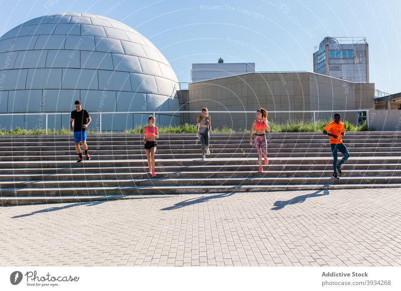 Sportspeople running in city during training runner sportspeople group together team unity cardio multiethnic multiracial diverse black african american workout