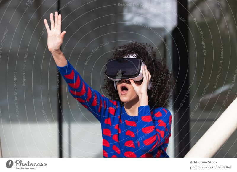 Excited black woman using VR headset in city vr glasses excited experience virtual reality goggles thrill female ethnic african american street device touch air