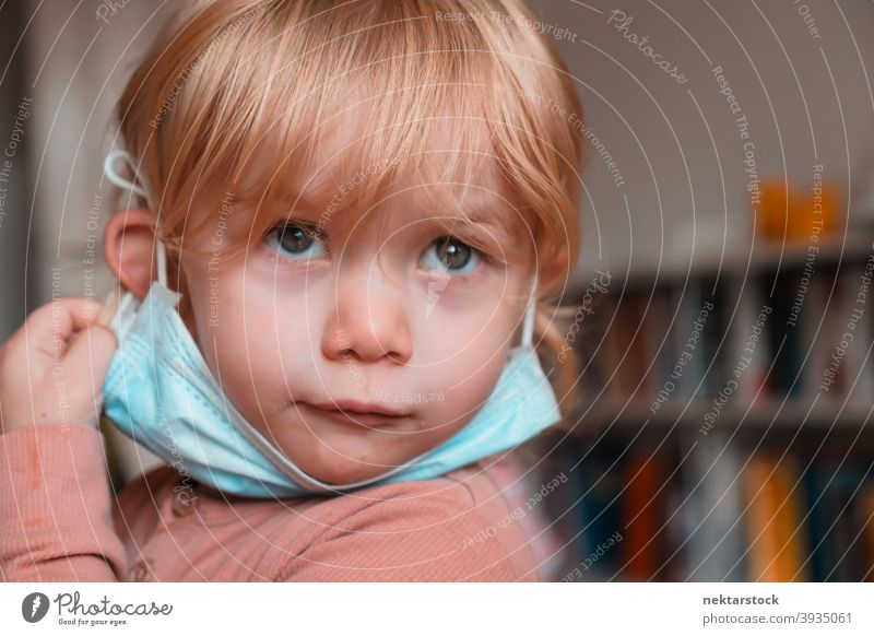 Child with Face Mask Under Chin mask child kid face female girl Indoor home at home caucasian face mask protective 2020 lockdown quarantine real life