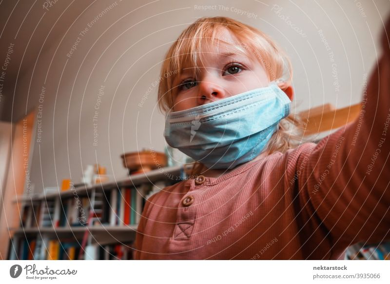 Two Year Old Girl with Face Mask Indoors mask child kid female girl home at home caucasian face mask protective 2020 lockdown quarantine real life real people