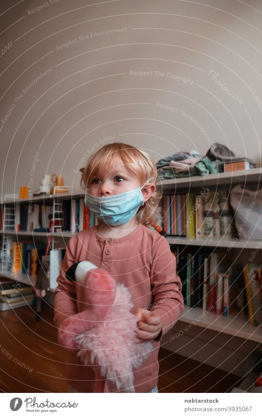 Child Wearing Face Mask at Home mask child kid female girl Indoor home at home caucasian face mask protective 2020 lockdown quarantine real life real people