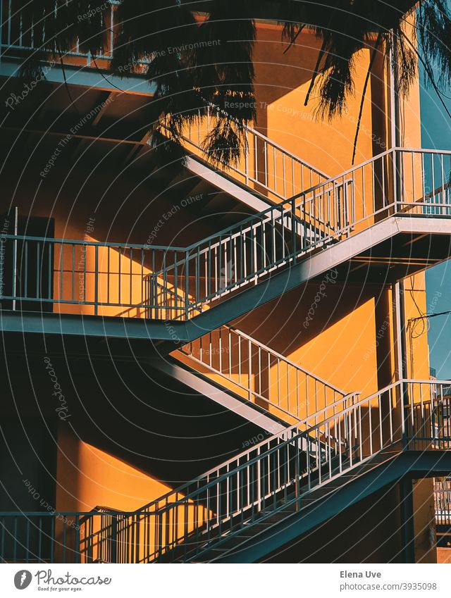 Colorful staircase with yellow wall on sunny day. Wallpaper of a building with copy space. Architecture Stairs Light City Street Copy Space Steps Yellow