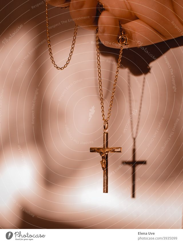 Pendant of crucified Christ with warm lights and shadow. crucifixion Christianity Religion and faith Shadow Moody mood Christmas Jesus Christ Hope Wallpaper