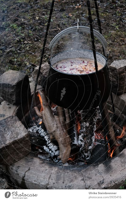 Hungarian fish soup over campfire boil Boiler Tripod Fire Fireplace Soup christmas dinner Embers Warmth Hot Flame Burn steam Soup kettle witch's cauldron