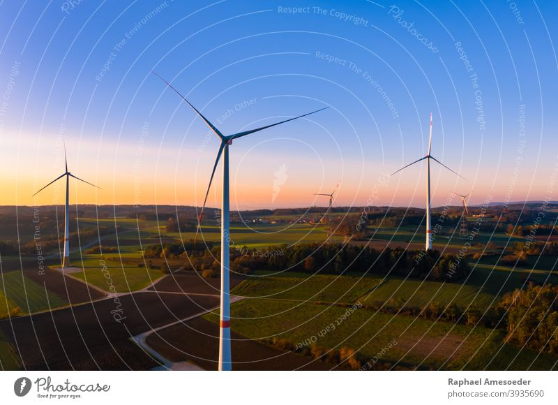 Aerial view of colorful autumn sunset at wind turbines aerial agriculture alternative blue clean construction countryside ecological ecology electric electrical