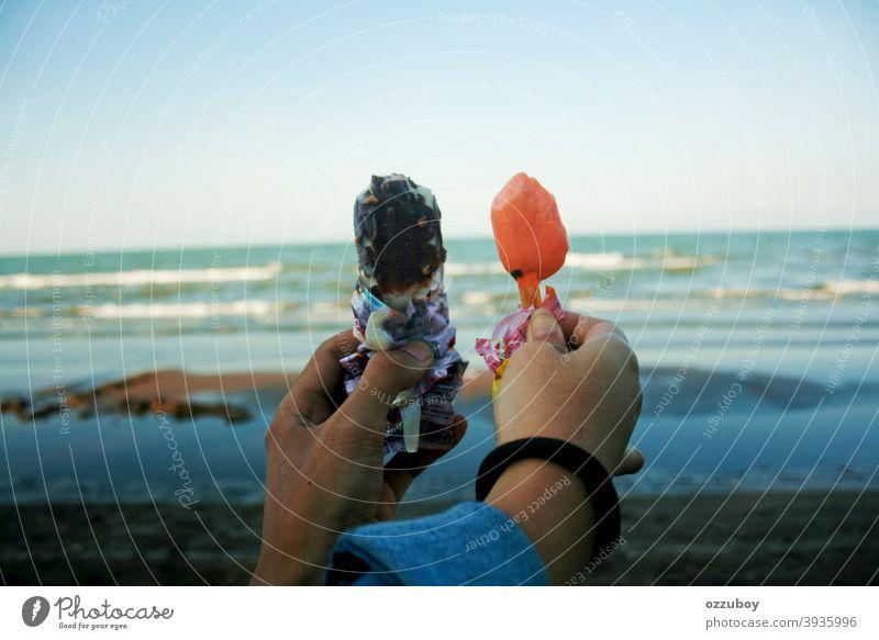 couple holding ice cream at beach Beach Day person summer fun adult hand friendship female woman dessert food sweet horizontal milky multiracial offspring pop