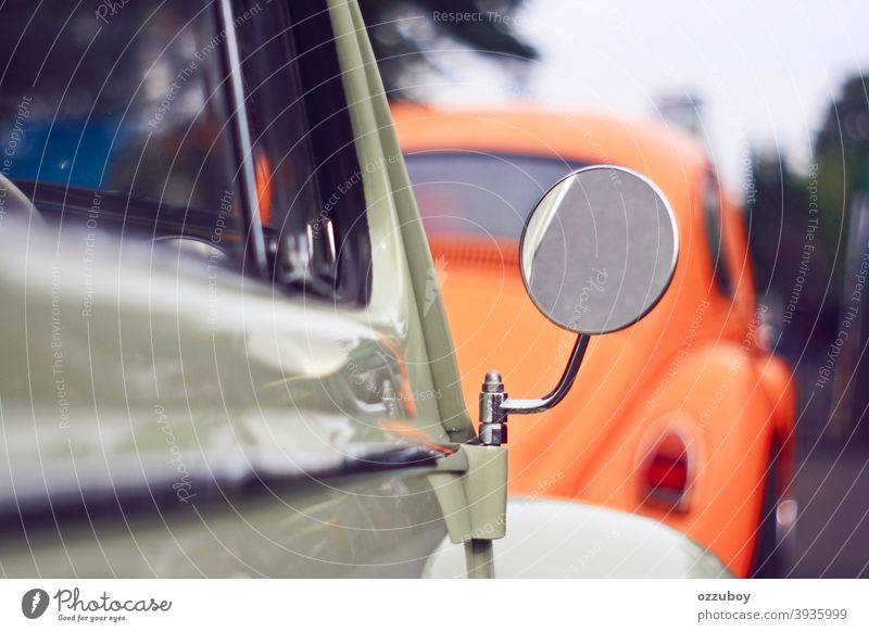 circle mirror horizontal transportation outdoors day color image reflection vintage car close-up side-view mirror old-fashioned retro style mode of transport