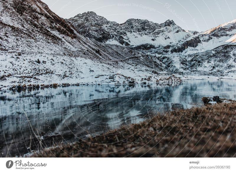 Mountain lake in winter in Arosa, Switzerland Winter Snow Alps Lake Water Blue Cold Tourism Destination Panorama (Format) Nature mountain lake arosa Grisons