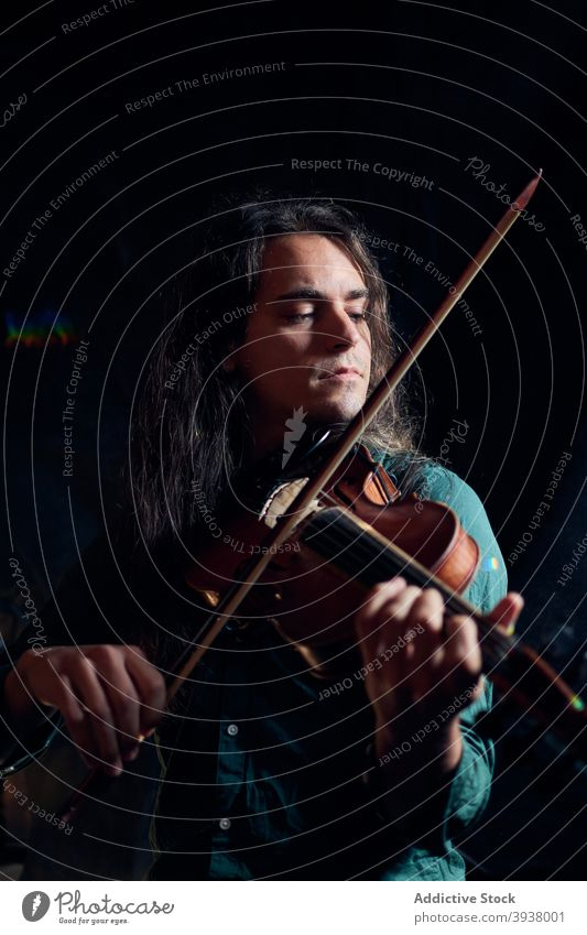 Man playing violin in dark room man music musician talent skill instrument sound melody male hobby song professional acoustic player concentrate perform