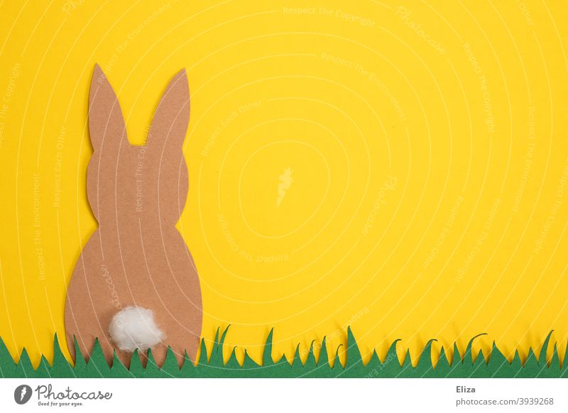 Easter crafts - Easter bunny sits in the grass on a yellow background Easter Bunny handicraft Handicraft rabbit Paper Grass Spring Yellow Easter decoration