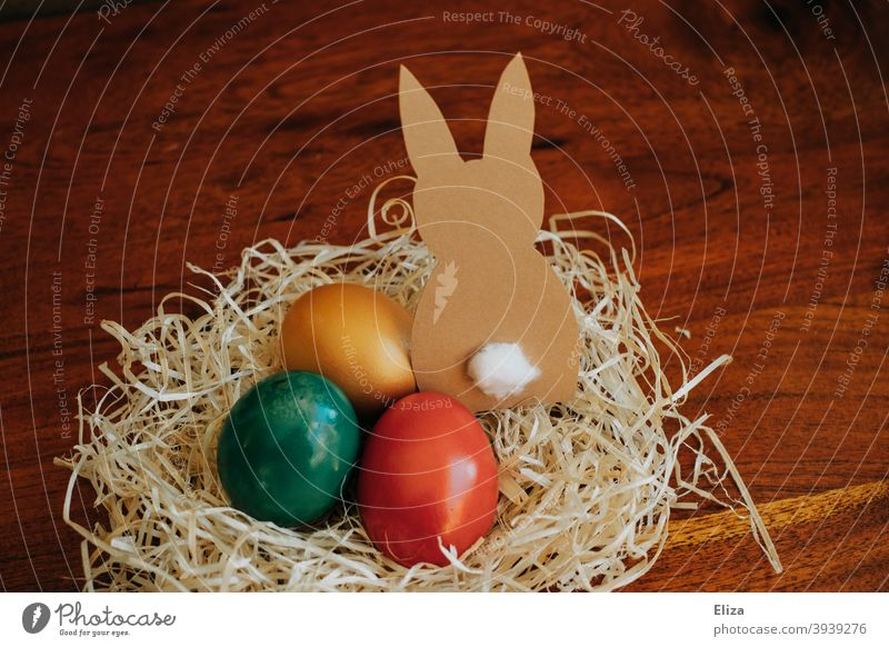 Easter nest with coloured eggs and a paper Easter bunny Easter egg nest Easter Bunny Nest colored Easter eggs variegated Decoration Home-made Easter decoration