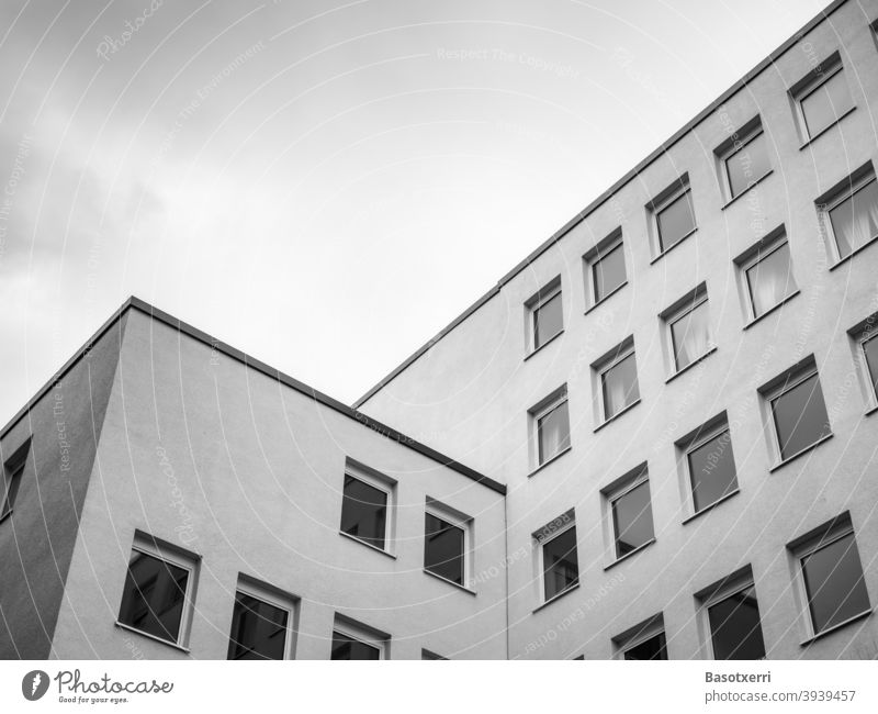 Sterile desolate apartment block in a big German city in grey winter weather, black and white shot Architecture dreariness block of flats Flat (apartment)