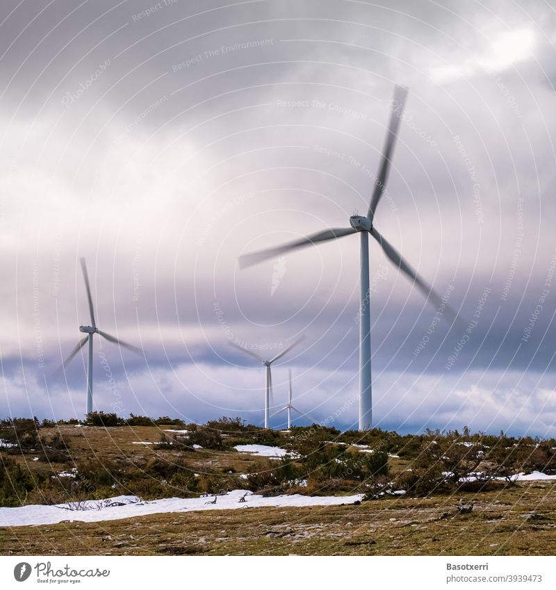 Wind turbines in the wind farm in nature, rotors in motion Wind energy plant wind power Renewable energy Energy industry Pinwheel Sky Environmental protection