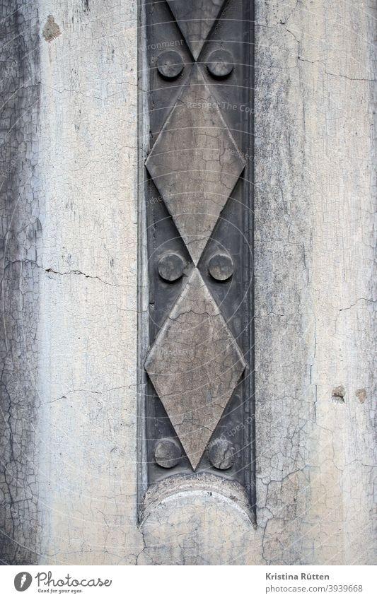 geometric pattern on house facade Ornament house wall Facade Wall (building) Wall (barrier) House (Residential Structure) Building ornamental facade element