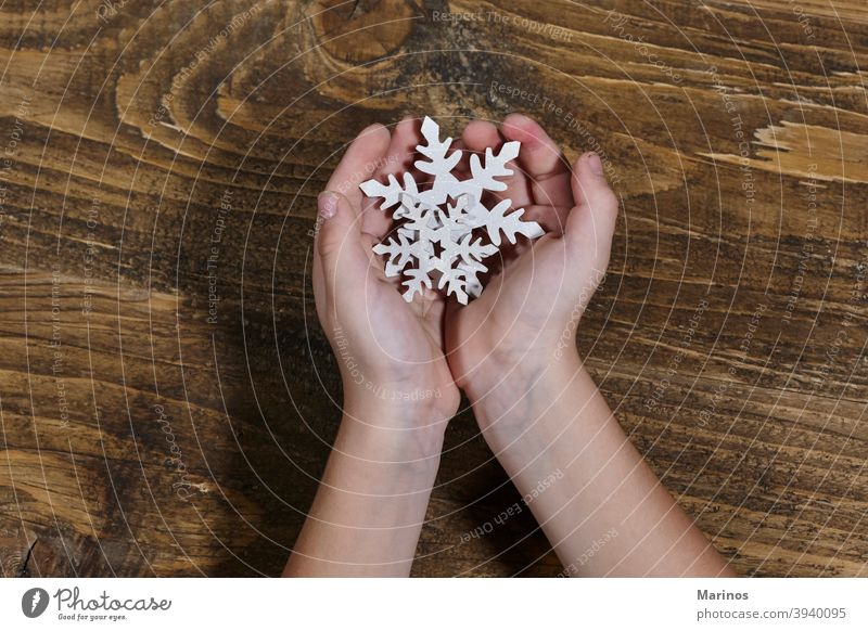 kid holding a wooden snowflake. young Snowflake Funny Happiness Snowfall Winter Lifestyle Studio shot Child background Hold christmas Decoration Playing