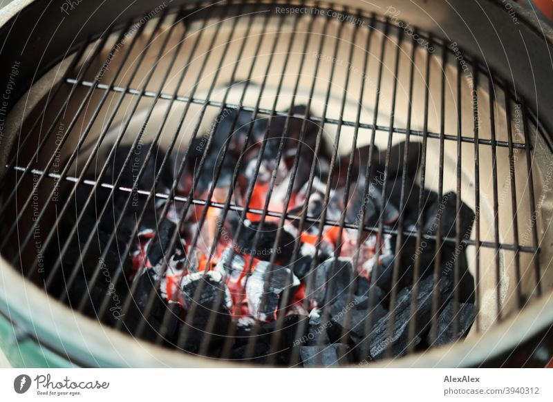 Glowing charcoal in a ceramic grill under the grill grate shortly after ignition Grill Charcoal embers grill grid Ceramic grill Kamado Kamado Grill Green