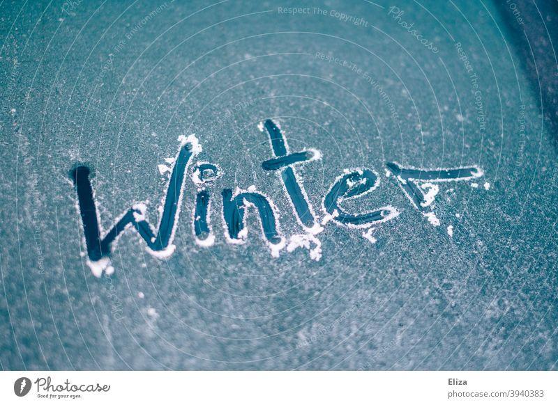 The word winter written on an icy car window Car window Frost Ice Winter Free Scratch Slice Frozen iced Car Window Windscreen Blue Cold Word authored