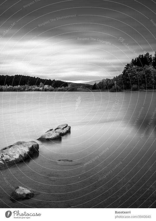 Dawn at the reservoir in black and white. Ullíbarri-Gamboa, Álava, Basque Country, Spain alava Reservoir Long exposure Black & white photo Exterior shot