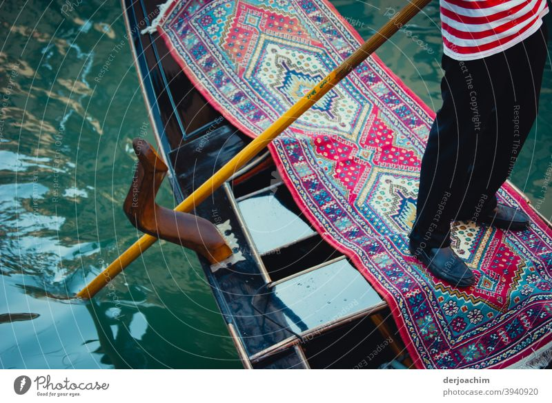 The gondolier in the boat stands on a carpet Venice Italy Canal Grande Watercraft Channel Gondola (Boat) Tourism Boating trip Gondolier Vacation & Travel Day