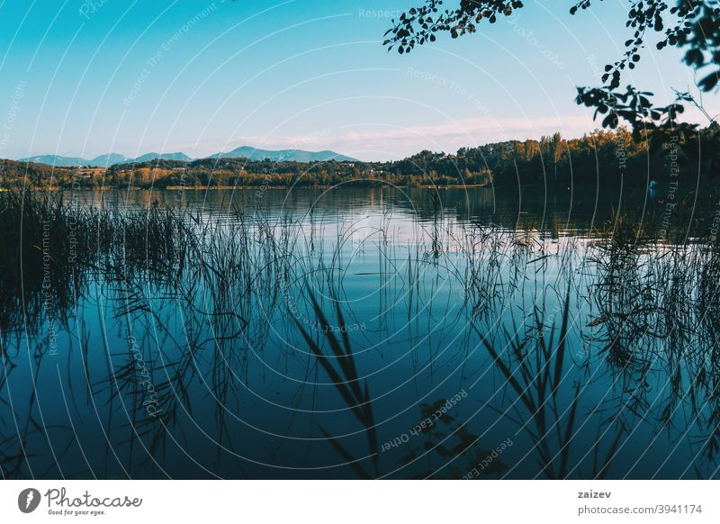 View of Banyoles Lake, in Gerona (Catalonia, Spain) peaceful relaxing calmness colours tranquility pure stage paradise quiet junk lagoon outside spanish