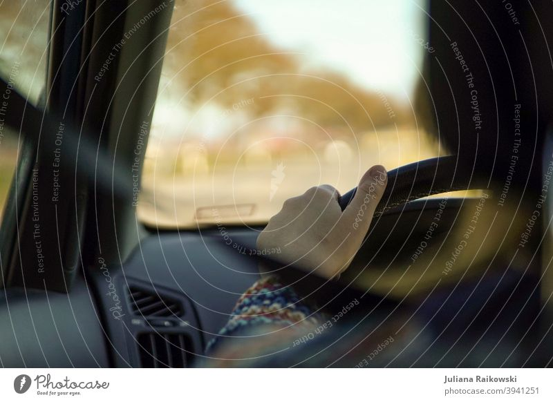 woman at the wheel Motoring Transport Colour photo Traffic infrastructure Street Road traffic Car Means of transport Driving Speed Highway Passenger traffic