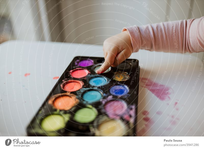 Close up child hand painting with watercolors Watercolor Watercolors Art Kindergarten Leisure and hobbies Painting and drawing (object) Painter Close-up Paper