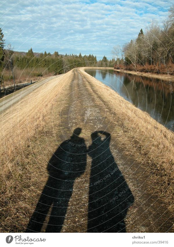 Shadows at the canal Autumn Bend Isar November Bavaria River Sewer Couple Lanes & trails Water In pairs