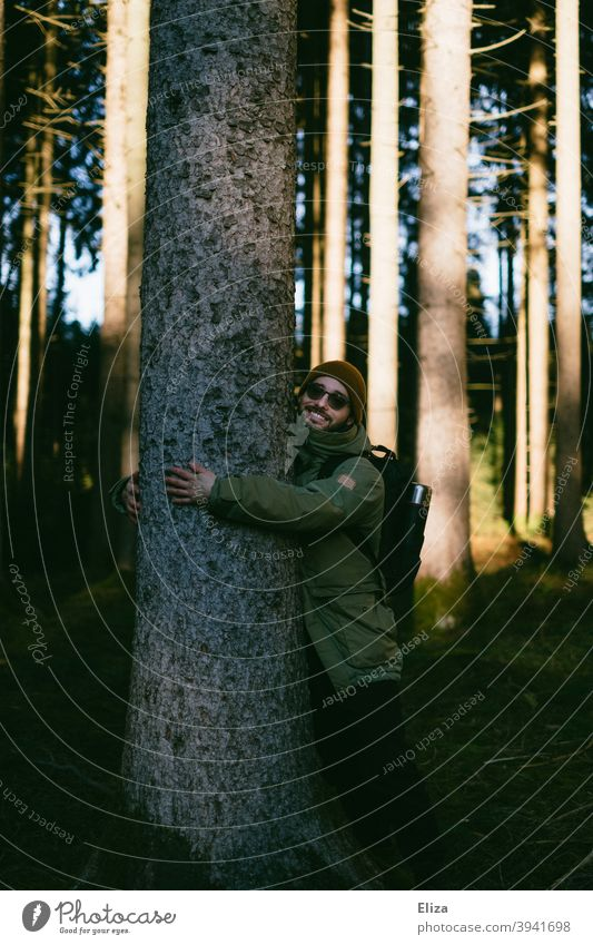 A man hugs a tree in the forest Forest Tree remarry Environmental protection Nature nature lovers close to nature Man Joy guard sb./sth. nature conservation