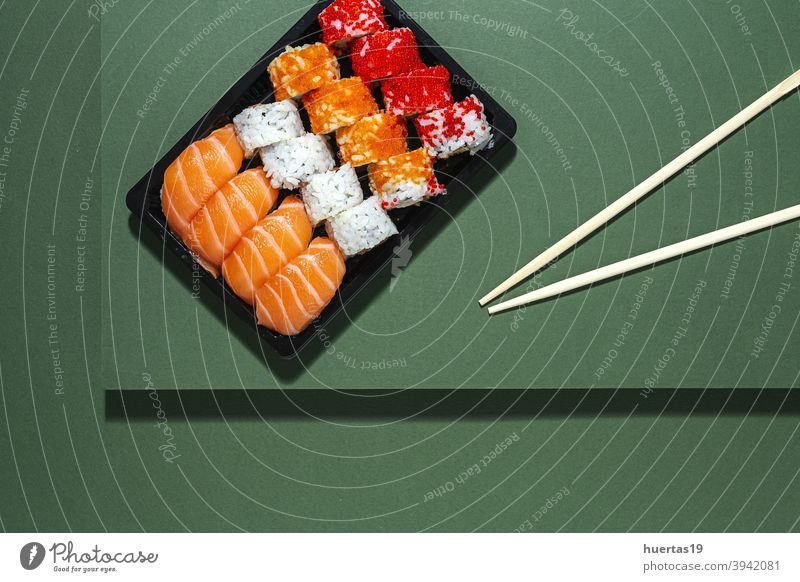 Japanese takeaway food concept. Sushi assortment to go Food Salmon Meal Fish Lunch Rice Box Asian Food Healthy Roll background Seafood Plastic Wasabi Fresh