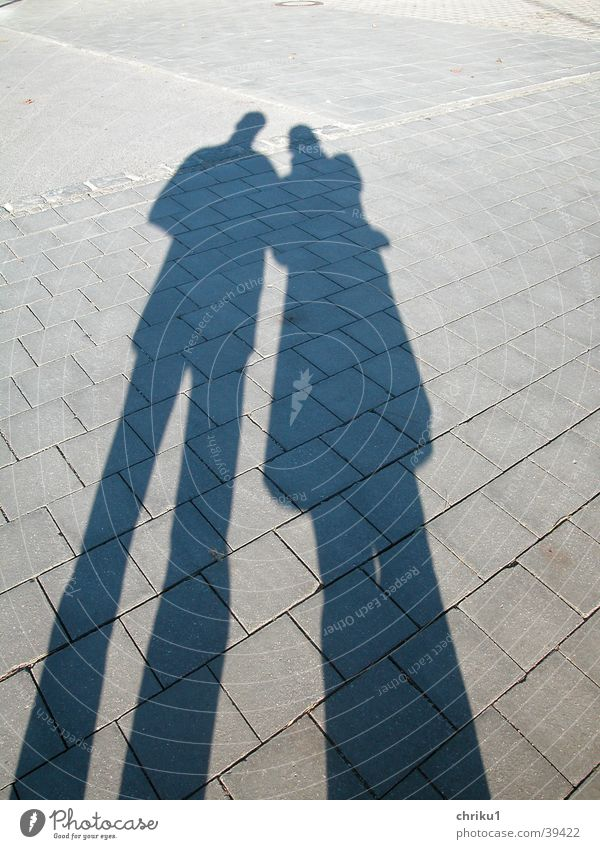 Woman Man Sun Love Couple Legs Graffiti In pairs Cobblestones Pedestrian precinct Stone slab