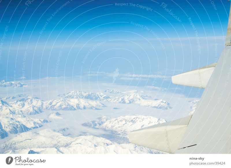 Sky Sun Blue Clouds Far-off places Snow Mountain Airplane Aviation Alps Wing