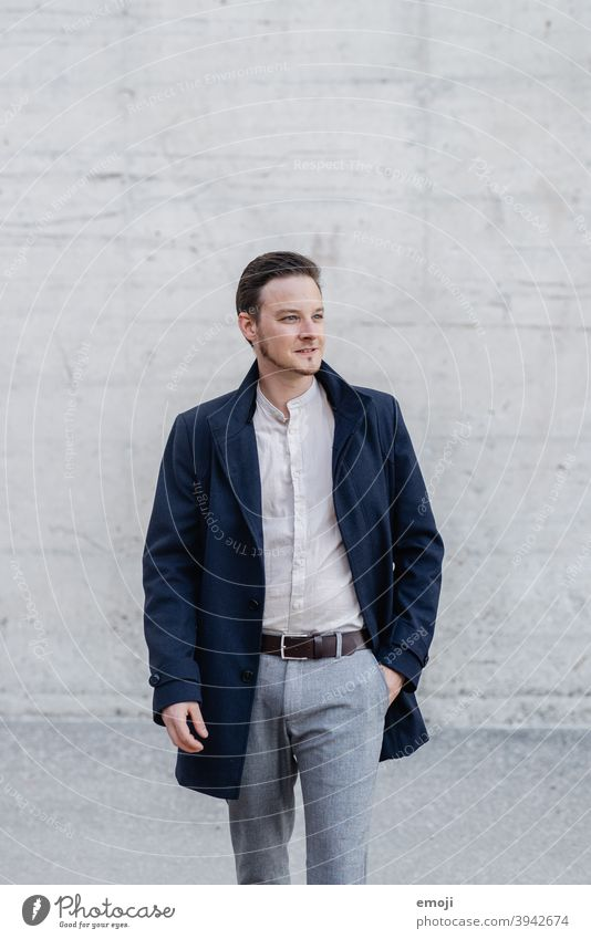 young man, business, outside in front of concrete wall masculine more adult Upper body Young man Man Friendliness Smiling Business Businessman Happiness