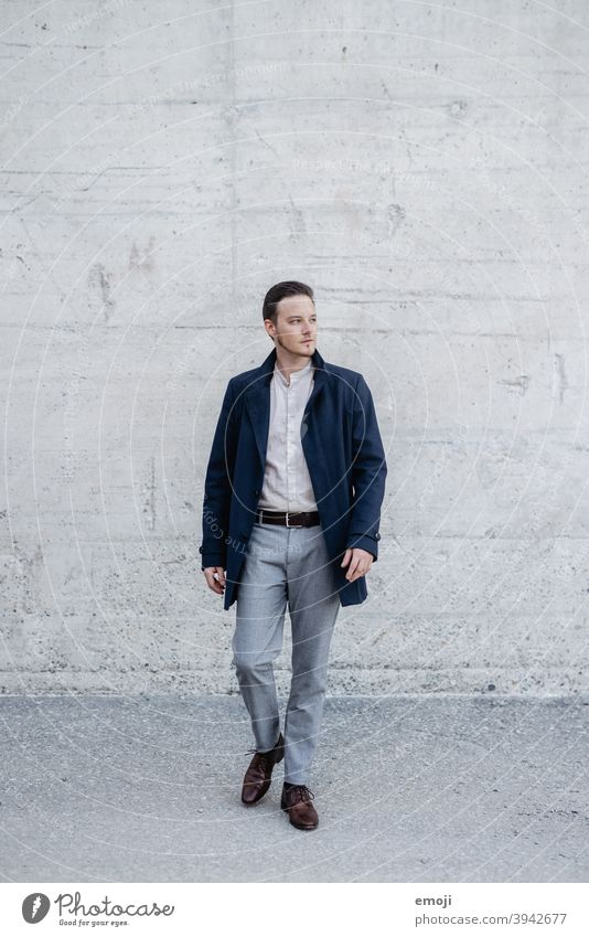 young man, business, outside in front of concrete wall masculine more adult Young man Man Business Businessman Concrete inquisitorial View to the side Doubt