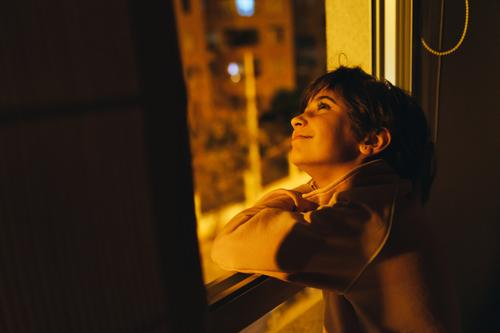 Girl looking out window at night to see the moon and stars. girl person young light people female human lady white dark think kid childhood natural cute home