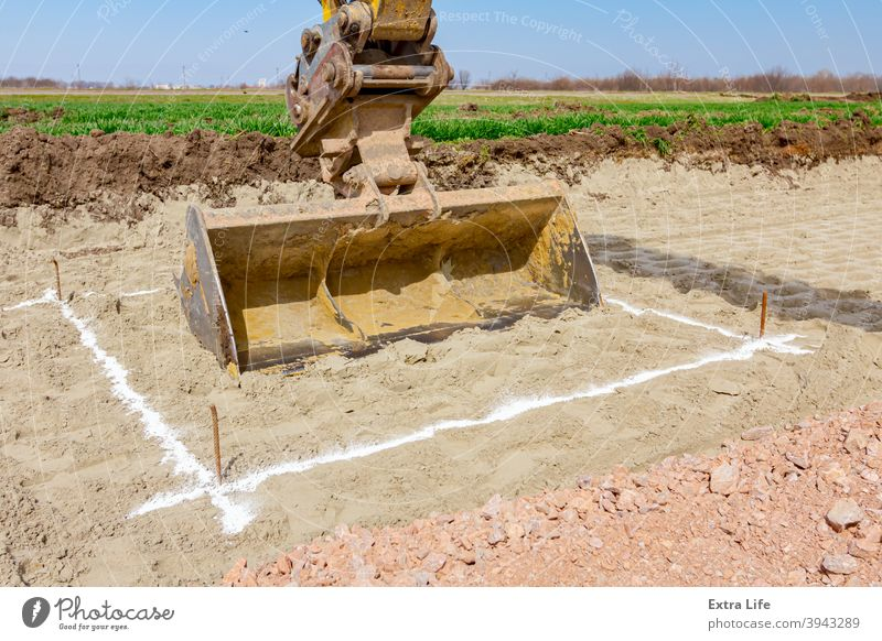 Excavator will dig precise inside marked area at building site Accurate Alignment Arm Backhoe Border Boundary Bucket Building Site Chalk Civil Engineering