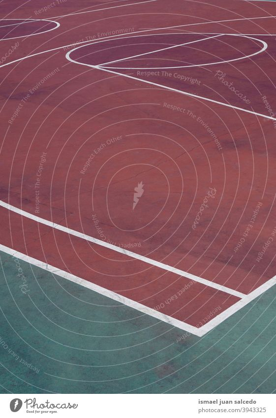red basket court, street basket in Bilbao city Spain basketball sport field lines markings colors colorful ground play playing park playground outdoors