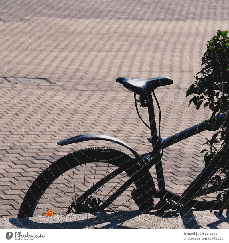 black bicycle on the street bike seat wheel shadow silhouette transportation ride biking cycling exercise outdoors lifestyle Bicycle tyre