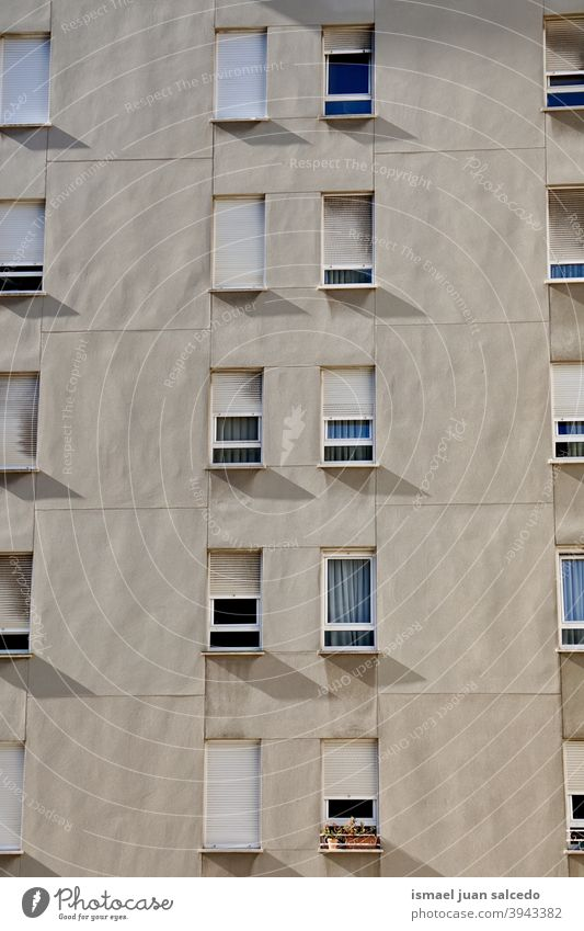windows on the white facade of the house, architecture in Bilbao city Spain building exterior building sterior home street outdoors structure built structure