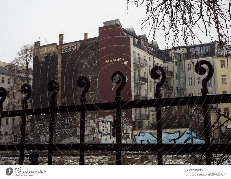 Paradise in cold unreal times Metalware Winter Fire wall Facade Architecture Word Wet Prenzlauer Berg Ravages of time Branches and twigs Graffiti Street art