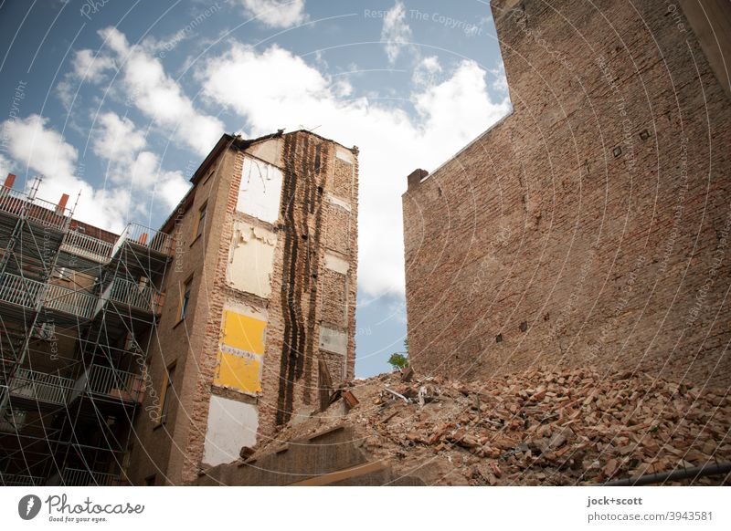 Redevelopment and demolition are close together Scaffold Backyard Downtown Berlin Architecture Fire wall Brick rubbish Trash heap rear building Destruction