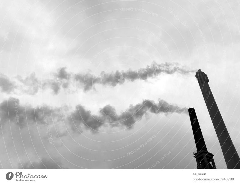 Smoking chimneys against a grey sky Chimney Vent Smoke exhaust gases Industry Public utilities Tower Emission CO2 emission Environmental pollution