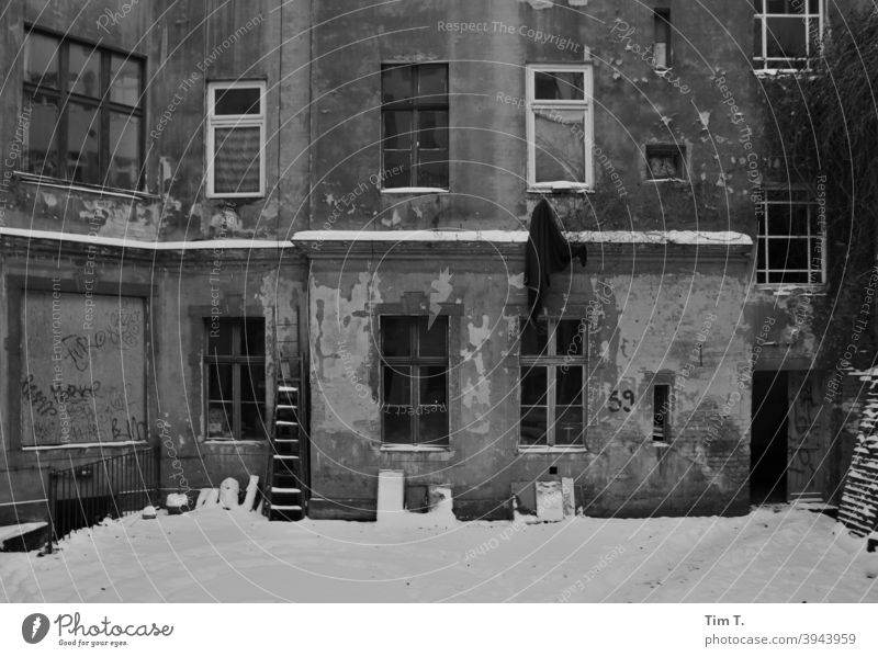 a snowy old backyard in Prenzlauer Berg Berlin b/w B/W Winter Snow Old building Black & white photo Architecture B&W Window Exterior shot Day Building Downtown