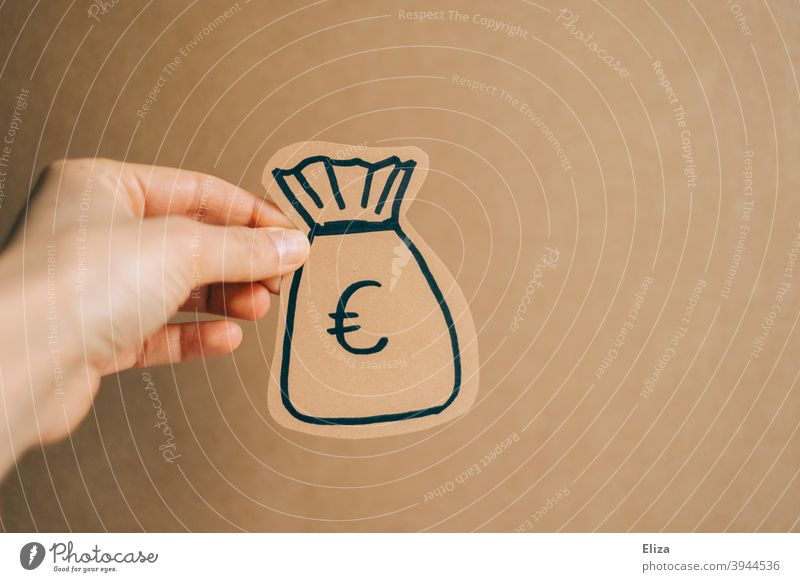 Hand holding a bag of money Sack Money Give donate finance capital financing Euro moneybags profit wages crowdfunding Paying investment Shopping yield assets