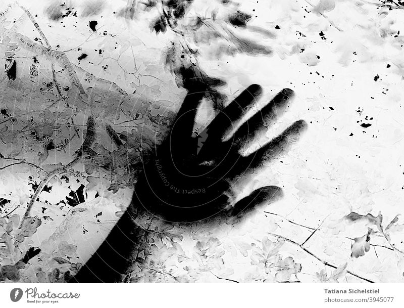 Black hand wipes from left to right with motion blur Hand blurred Creepy Black & white photo Inverted Crime thriller Threat Fear Help Shadow Wipe