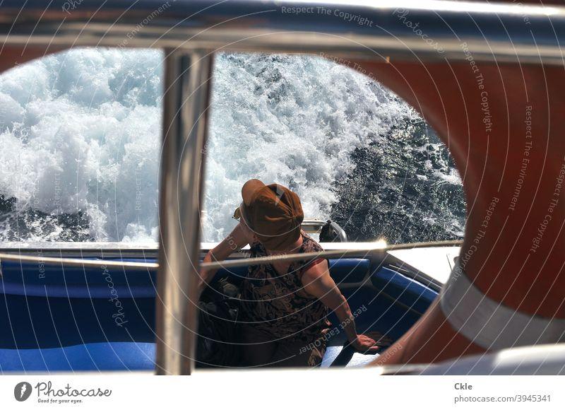 boat trip ship Wake Woman Hat Life belt Ocean outlook Trip Boating trip Water Railing Navigation Watercraft Exterior shot Vacation & Travel Maritime