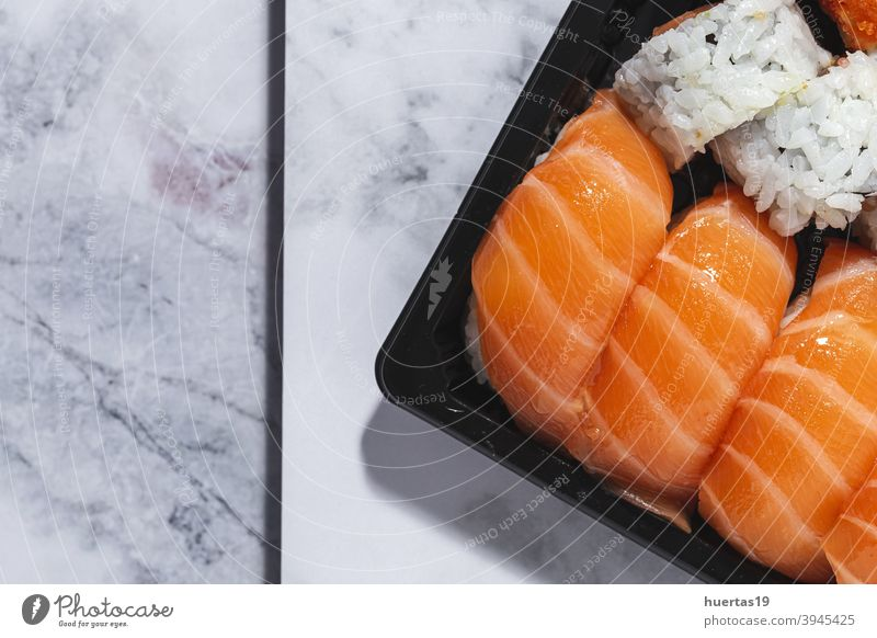 Japanese food concept to go. Sushi take away assortment japanese sushi salmon meal fish lunch rice box asian food healthy roll background seafood plastic wasabi