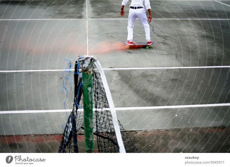 skateboarder playing in tennis court with pink smoke on skateboard leisure life balance subculture background copy space one person real people equipment deck