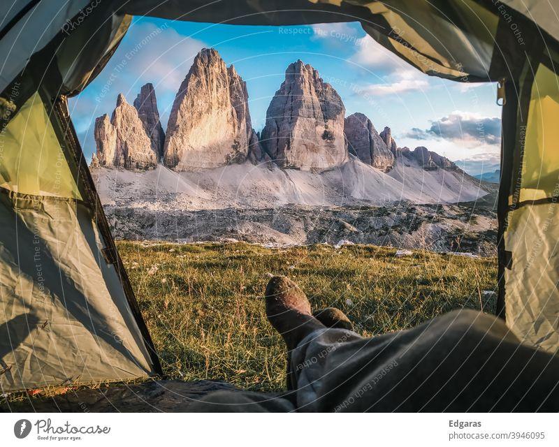 A man inside a tent in dolomites mountains, Tre cime di Lavaredo, Italy Dolomites dolomiti Tent Inside a tent Mountains tent Tre Cime di Lavaredo Hike Hiker